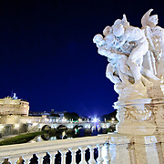 ROME, Italy - A night shot of the famous jail the Castel Sant'Angelo in Rome, Italy, with marble statues in the foreground decorating one of the bridges across the Tiber.