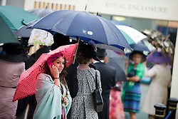 © licensed to London News Pictures.16/06/2011. Ascot, UK.  Rain soaked race goers at Ladies day at Royal Ascot races today (16/06/2011). The 5 day showcase event is one of the highlights of the racing calendar. Horse racing has been held at the famous Berkshire course since 1711 and tradition is a hallmark of the meeting. Top hats and tails remain compulsory in parts of the course. Photo credit should read: Ben Cawthra/LNP