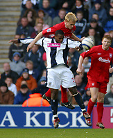 Photo: Dave Linney.<br />West Bromwich Albion v Liverpool. The Barclays Premiership. 01/04/2006.Liverpool's Sami Hyypia (Top) rises above Nathan Ellington to challenge for the ball