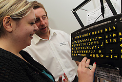 Demonstration of adapted computer featuring clear,  enlarged keyboard at the Mysight charity for people with visual impairments.