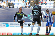 Callum Camps shoots during the EFL Sky Bet League 1 match between Wigan Athletic and Rochdale at the DW Stadium, Wigan, England on 24 February 2018. Picture by Daniel Youngs.