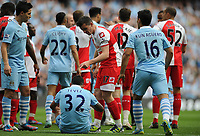 Football - Premier League - Manchester City vs. Queens Park Rangers<br /> Joey Barton of Queens Park Rangers points at Manchester City's Carlos Tevez following the foul that earns Barton a straight red card at the Etihad Stadium, Manchester