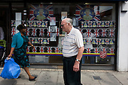 Days before the Queen's diamond Jubilee weekend, elaborate display of patriotic flags and historical royal portraits adorn the window of a Salvation Army charity shop in south London.