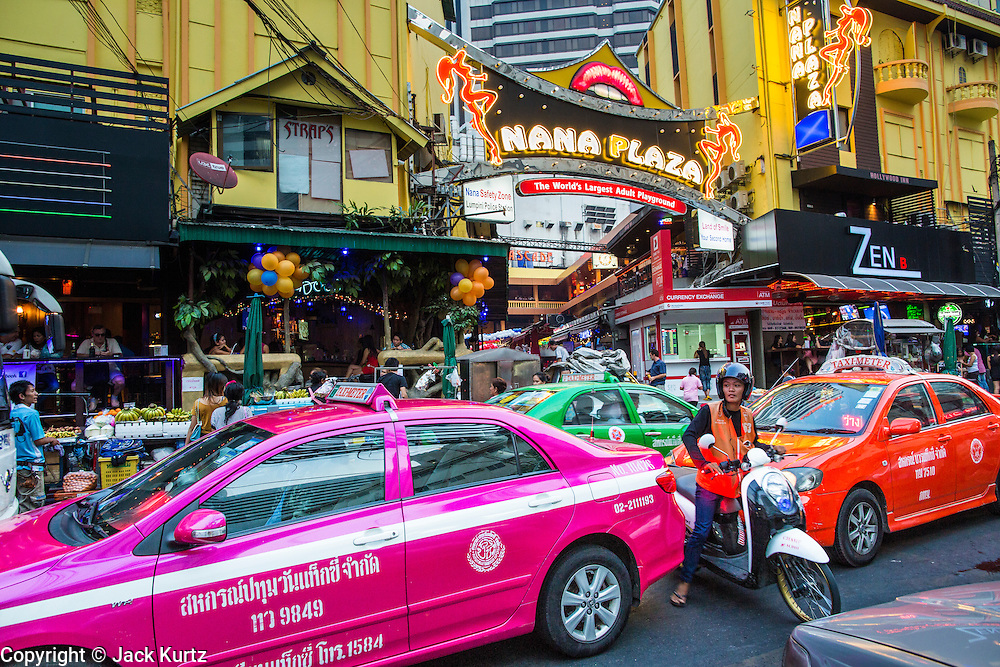 "21 JANUARY 2013 - BANGKOK, THAILAND: Traffic in front of the Nana Entertainment Plaza, a red light district in Bangkok. Prostitution in Thailand is technically illegal, although in practice it is tolerated and partly regulated. Prostitution is practiced openly throughout the country. The number of prostitutes is difficult to determine, estimates vary widely. Since the Vietnam War, Thailand has gained international notoriety among travelers from many countries as a sex tourism destination. One estimate published in 2003 placed the trade at US$ 4.3 billion per year or about three percent of the Thai economy. It has been suggested that at least 10% of tourist dollars may be spent on the sex trade. According to a 2001 report by the World Health Organisation: ""There are between 150,000 and 200,000 sex workers (in Thailand).""   PHOTO BY JACK KURTZ"