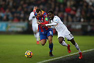 Nathan Dyer of Swansea city ® tries to go past James McArthur  of Crystal Palace. Premier league match, Swansea city v Crystal Palace at the Liberty Stadium in Swansea, South Wales on Saturday 23rd December 2017.<br /> pic by  Andrew Orchard, Andrew Orchard sports photography.