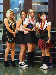 """© Licensed to London News Pictures . 15/12/2012 . Manchester , UK . Women in fancy dress as schoolgirls . Revellers enjoy a wet but busy night out on one of the last weekends before Christmas , a traditionally busy time when office parties and clubbers decent on bars and clubs , often known as """" Mad Friday """" . Photo credit : Joel Goodman/LNP"""