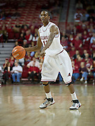 Nov 16, 2011; Fayetteville, AR, USA;  Arkansas Razorbacks guard BJ Young (11) dribbles the ball during a game against the Oakland Grizzlies at Bud Walton Arena. Arkansas defeated Oakland 91-68. Mandatory Credit: Beth Hall-US PRESSWIRE