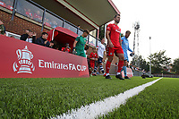 Football - 2021 / 2022 Emirates FA Cup - First Round Qualifying - Worthing vs Corinthian-Casuals - The Crucial Environment Stadium, Woodside Road - Saturday 4th September 2021<br /> <br /> Worthing's Aarran Racine and Danny Bracken of Corinthian Casuals lead there sides out for kick off The Crucial Enviromental Stadium  <br /> <br /> COLORSPORT/SHAUN BOGGUST