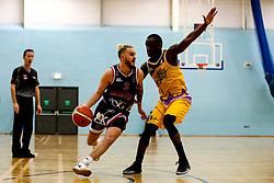 Jordan Nicholls of Bristol Flyers takes on Ladarius Tabb of London Lions - Photo mandatory by-line: Robbie Stephenson/JMP - 10/04/2019 - BASKETBALL - UEL Sports Dock - London, England - London Lions v Bristol Flyers - British Basketball League Championship