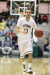 16 November 2013: Bryce Dolan during an NCAA mens division 3 basketball game between the Aurora University Spartans and the Illinois Wesleyan Titans in Shirk Center, Bloomington IL