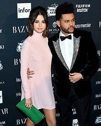 L-R: Musicians Selena Gomez and The Weeknd attend the Harper's Bazaar Icons by Carine Roitfeld celebration at The Plaza Hotel in New York, NY on September 8, 2017.  (Photo by Stephen Smith/SIPA USA)