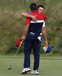 Team USA's Collin Morikawa (left) hugs Team Europe's Viktor Hovland after securing enough points to win the Ryder Cup for Team USA on the 18th hole during day three of the 43rd Ryder Cup at Whistling Straits, Wisconsin. Picture date: Sunday September 26, 2021.