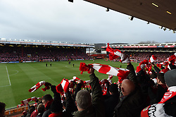 Bristol City fans waves their flags as their team emerge from the tunnel in the FA Cup fourth round match between Bristol City and West Ham United at Ashton Gate on 25 January 2015 in Bristol, England - Photo mandatory by-line: Paul Knight/JMP - Mobile: 07966 386802 - 25/01/2015 - SPORT - Football - Bristol - Ashton Gate - Bristol City v West Ham United - FA Cup fourth round