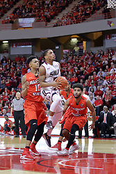 22 February 2017:  Leo Vincent lifts off for the hoop after passing by Phil Fayne(10) and Keyshawn Evans(3) during a College MVC (Missouri Valley conference) mens basketball game between the Southern Illinois Salukis and Illinois State Redbirds in  Redbird Arena, Normal IL
