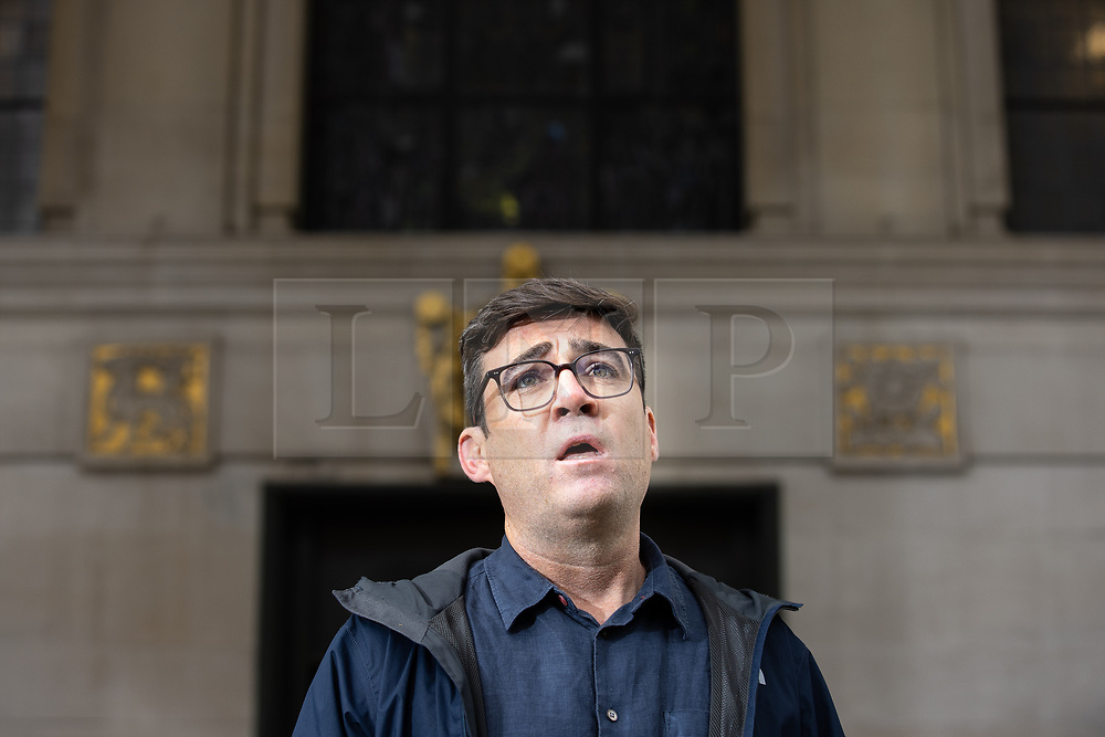 © Licensed to London News Pictures. 15/10/2020. Manchester, UK. Manchester Metro Mayor Andy Burnham speaks at a press conference in front of Manchester Central Library in St Peter's Square , central Manchester , as negotiations continue regarding placing the city on a Tier 3 lockdown, closing pubs and limiting the ways in which households can mix, in order to reduce the spread of Coronavirus . Photo credit: Joel Goodman/LNP