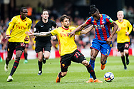 Watford (16) Abdoulaye Doucouré, Watford (21) Kiko Femenía, Wilfried Zaha (11) of Crystal Palace  during the Premier League match between Watford and Crystal Palace at Vicarage Road, Watford, England on 21 April 2018. Picture by Sebastian Frej.