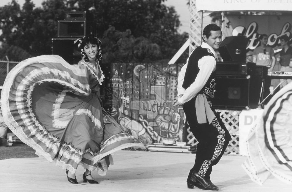 (original in color)  Hispanic dancers in Austin, Texas Cinco de Mayo festival.