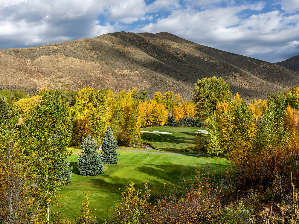 Sun Valley Resort Golf Course Trail Creek Hole #17 par 3 on a Brilliant Autumn Day with fall colors abounding and sage cover foothills of Trail Creek Mountains in the background. Licensing and Open Edition Prints.