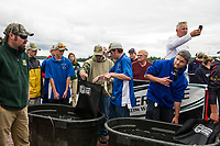 Brett Clairmont, John Woodaman and Tim Gentile of the Gilford team line up for weigh on Thursday afternoon during NHIAA State Qualifier Bass Fishing at Center Harbor Beach on Lake Winnipesaukee.  (Karen Bobotas/for the Laconia Daily Sun)