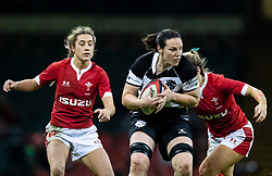 Paula Fitzpatrick of Barbarians under pressure from  Kerin Lake of Wales<br /> <br /> Photographer Simon King/Replay Images<br /> <br /> Friendly - Wales v Barbarians - Saturday 30th November 2019 - Principality Stadium - Cardiff<br /> <br /> World Copyright © Replay Images . All rights reserved. info@replayimages.co.uk - http://replayimages.co.uk
