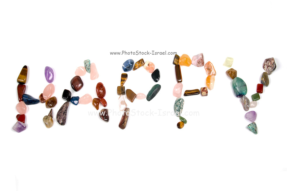 New age crystals and gemstones spelling out Happy