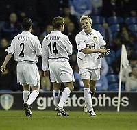 Photo. Aidan Ellis.<br /> Leeds United v Manchester City.<br /> FA Barclaycard Premiership.<br /> 22/03/2004.<br /> Leeds Alan Smith smiles with goal scorer Stephen McPhail
