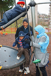 Asian family at playground.