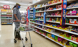© Licensed to London News Pictures. 09/09/2021. London, UK. A shopper shopping in Sainsbury's supermarket in north London. Supermarket bosses warn that prices will rise across the retail industry in the coming months due to coronavirus pandemic disruption and a shortage of HGV drivers. Photo credit: Dinendra Haria/LNP