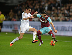 Jack Cork of Swansea City battles for the ball with Mauro Zarate of West Ham United - Mandatory byline: Alex James/JMP - 07966 386802 - 20/12/2015 - FOOTBALL - Liberty Stadium - Swansea, England - Swansea City v West Ham United - Barclays Premier League