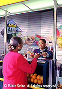 Active Aging Senior Citizens, Retired, Activities, African American Woman Buys Healthy Drink at Food Court