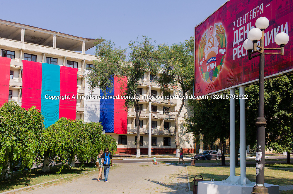 20150829  Moldova, Transnistria,Pridnestrovian Moldavian Republic (PMR) Tiraspol. A billboard celebrating the 25th year of existence of Transnistria, and an appartmentbuilding is being decorated with giant Transnistrian and Russian banners brotherly next to each other.