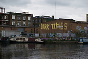Graffiti at the junction between the Lea Navigational Canal and the Hertford Canal in East London, England, United Kingdom. This street art reads as slogans which are prophetic and political.