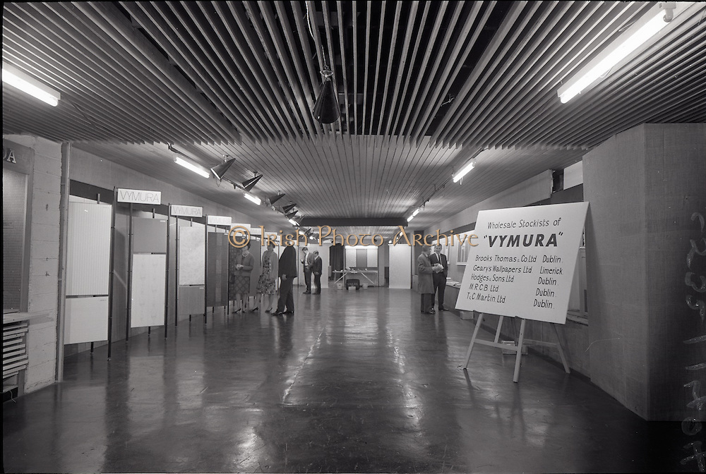"""25/06/1965<br /> 06/25/1965<br /> 25 June 1965<br /> Views of the I.C.I. (Imperial Chemical Industries) """"Vymura"""" wallpaper exhibition at the Building Centre, Baggott Street, Dublin. Board on right gives a list of wholesale stockists in Ireland."""