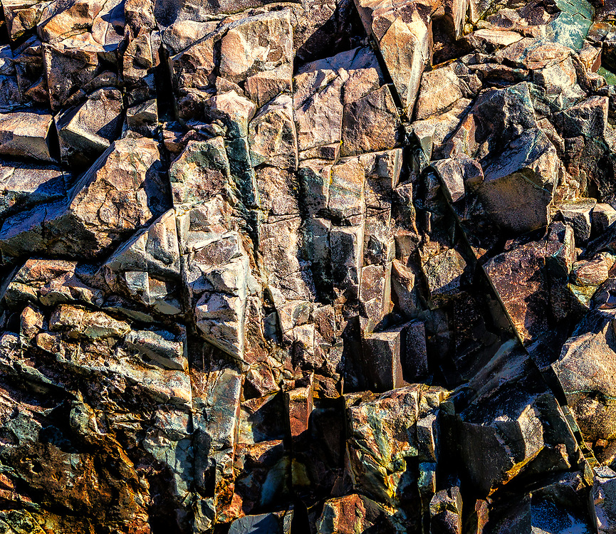 """Igneous rock, hundreds of millions of years old, with iron and maybe some copper, in a formation reminicent of """"cubism'. Close inspection will reveal an old man's face."""