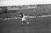 Galway runs with the ball followed close by Cork during the All Ireland Senior Gaelic Football Championship Final Cork v Galway in Croke Park on the 23rd September 1973. Cork 3-17 Galway 2-13.