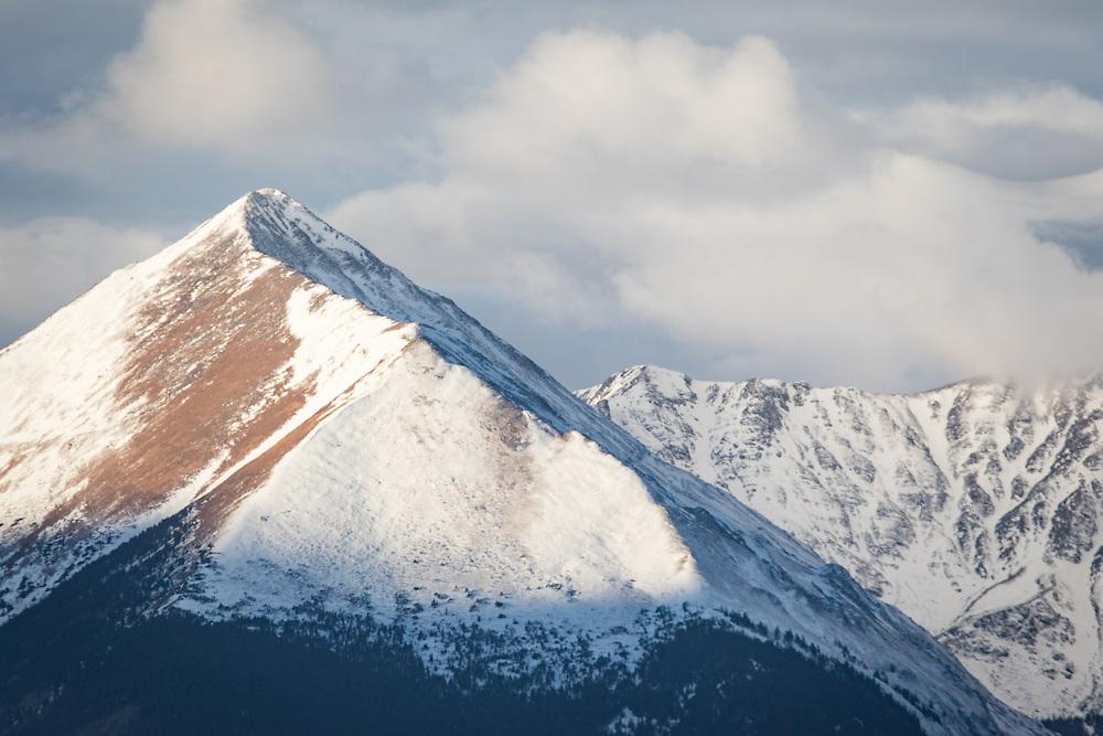 Early morning sun hits snowy Horn Peak.
