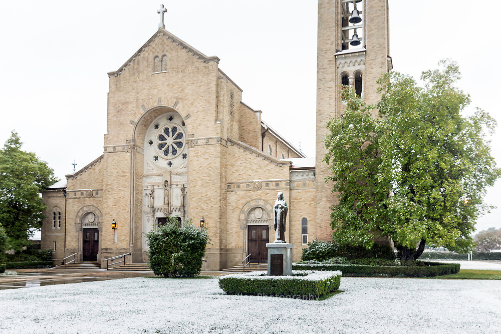 Snow covers the grounds of Sacred Heart of Jesus Catholic Church after a rare snowstorm dropped between 3-6 inches of snow in the Baton Rouge and South Louisiana area Friday, December 8, 2017.