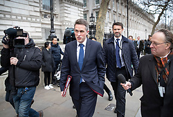 © Licensed to London News Pictures. 18/12/2018. London, UK. Defence Secretary Gavin Williamson leaves Downing Street and is questioned by Channel Four Political Correspondent Michael Crick (R) after attending cabinet. Photo credit: Peter Macdiarmid/LNP