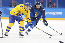 February 18, 2018 - Pyeongchang, KOREA - Sweden defenseman Erik Gustafsson (29) and Finland forward Jani Lajunen (24) in a hockey game between Sweden and Finland during the Pyeongchang 2018 Olympic Winter Games at Kwandong Hockey Centre. Sweden beat Finland 3-1. (Credit Image: © David McIntyre via ZUMA Wire)