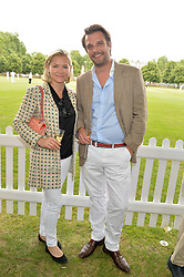 CHRISTINA KNUDSEN and RICHARD STEELE at the Flannels for Heroes Cricket tournament in association with Dockers in aid of the charities Walking With The Wounded, On Course Foundation and Combat Stress held at Burton Court, London on 20th June 2014.
