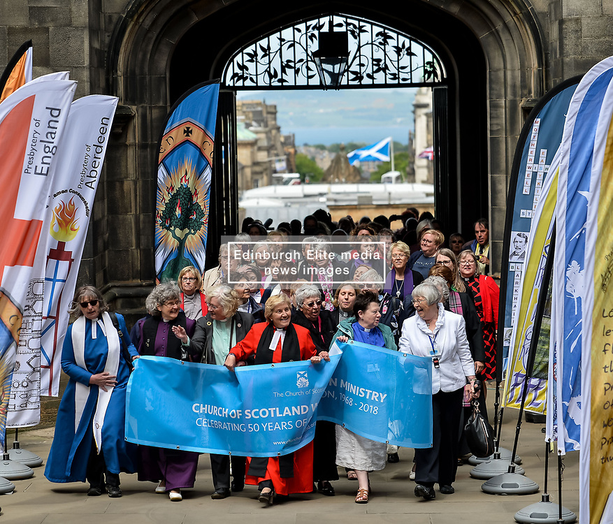 Pictured: Women ministers and supporters march into the quad of the General Assembly, led by former Moderator the Reverend Lorna Hood.<br /> <br /> Women ministers and supporters processed up the Mound in Edinburgh to the General Assembly of the Church of Scotland to mark 50 years since the Church allowed the ordination of women.<br /> <br /> © Dave Johnston / EEm