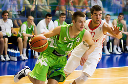 Matej Rojc of Slovenia vs Ahmet Tuncer of Turkey during basketball match between National teams of Turkey and Slovenia in Qualifying Round of U20 Men European Championship Slovenia 2012, on July 17, 2012 in Domzale, Slovenia. (Photo by Vid Ponikvar / Sportida.com)