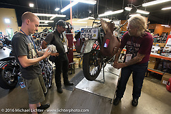 Thomas Trapp works with his mechanic son on their 1916 Harley-Davidson F in the open shop at Appleton Harley-Davidson in Clarksville, Tennessee during Stage 4 of the Motorcycle Cannonball Cross-Country Endurance Run, which on this day ran from Chatanooga to Clarksville, TN., USA. Monday, September 8, 2014.  Photography ©2014 Michael Lichter.