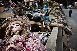 A doll sits in debris in town devastated by tsunami in Otsuchi, Iwate prefecture, Japan, April 4, 2011. Thousands of Japanese and American military personnel joined together Friday in a final three-day sweep to search for those still missing from last month's massive earthquake and tsunami.