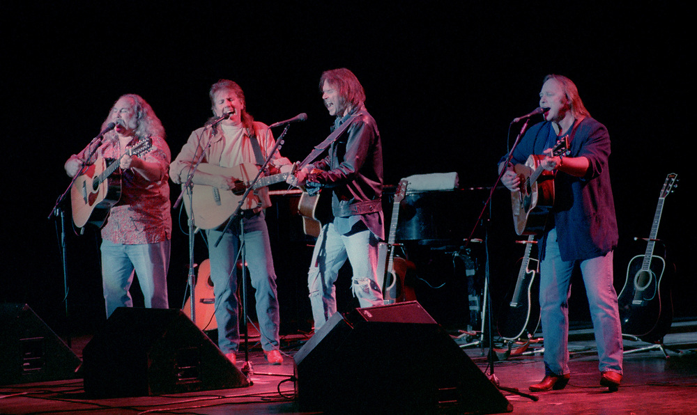 David Crosby, Graham Nash, Neil Young and Stephen Stills perform at the Santa Monica Civic Auditorium in a concert to benefit former drummer Dallas Taylor. 3-31-90.