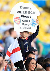 An England fan in the stands asks for Danny Welbeck's shirt during the International Friendly match at Elland Road, Leeds.