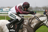 Jockey Adam Wedge soaked and covered i mud brings Silver Streak home in the 3.25pm The Betway Aintree Hurdle (Grade 1) 2m 4fduring the Grand National Festival Week at Aintree, Liverpool, United Kingdom on 4 April 2019.