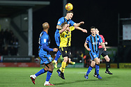 Gillingham midfielder Mark Byrne wins the ball in the air during the EFL Sky Bet League 1 match between Burton Albion and Gillingham at the Pirelli Stadium, Burton upon Trent, England on 12 January 2019.