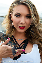 Trinity Conrad of the Flaunt Girls in Weirs Beach during Weirs Beach during Laconia Motorcycle Week. NH. USA. Tuesday June 12, 2018. Photography ©2018 Michael Lichter.