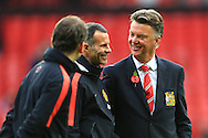 Louis Van Gaal, manager of Manchester United jokes with Ryan Giggs - Manchester United vs. Crystal Palace - Barclay's Premier League - Old Trafford - Manchester - 08/11/2014 Pic Philip Oldham/Sportimage